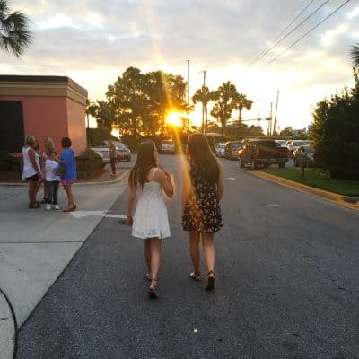 Teenage girls walking into the sunset at Panama city beach florida