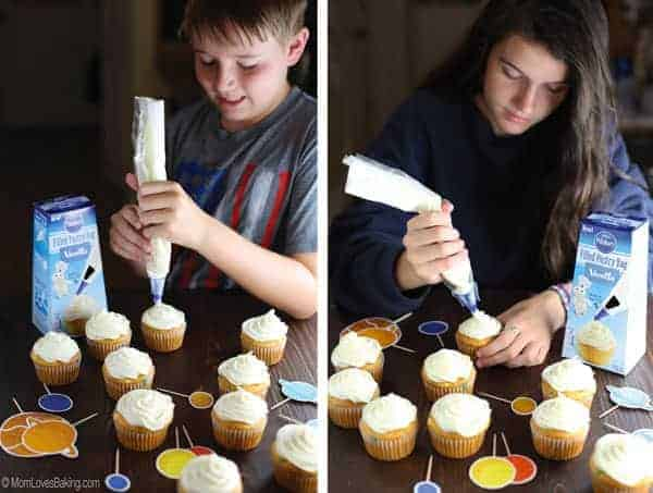 Kids frosting Solar System Cupcakes