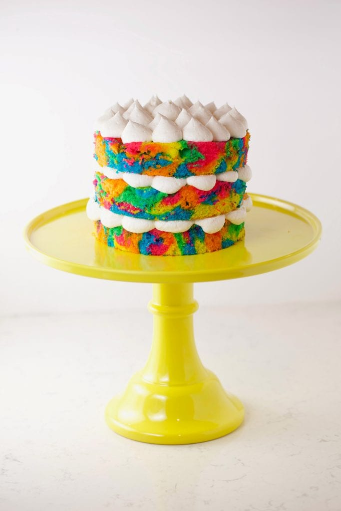 Tie dye cake on yellow cake stand