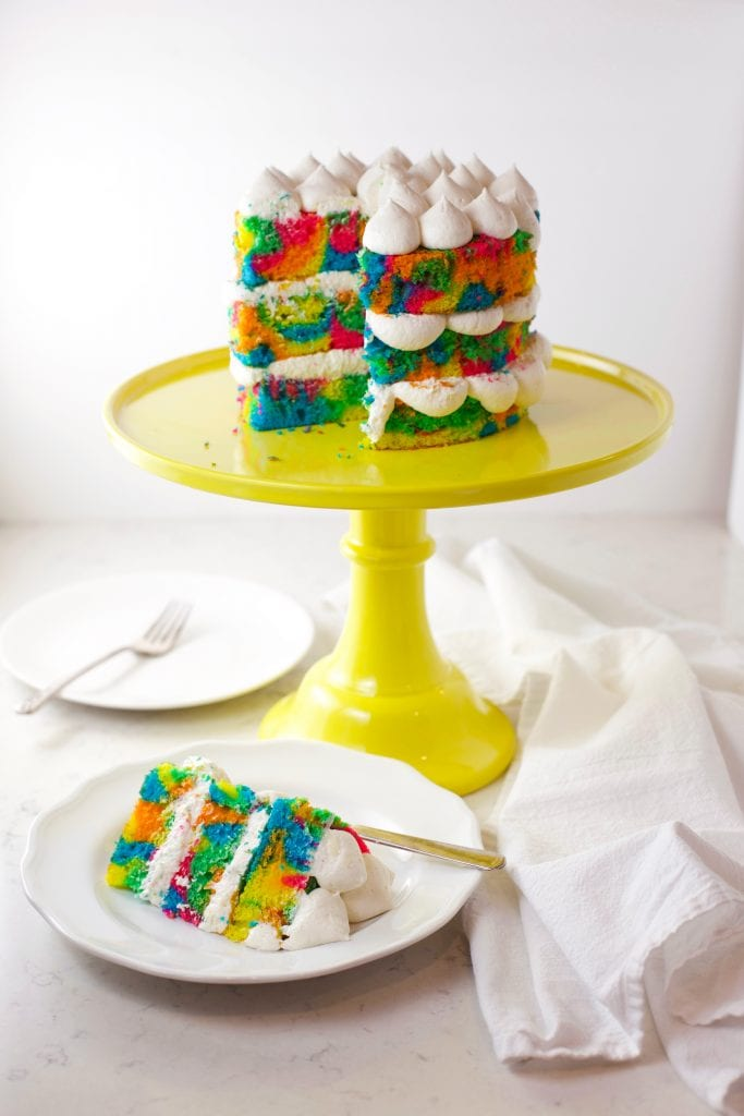 Rainbow tie dye cake sliced