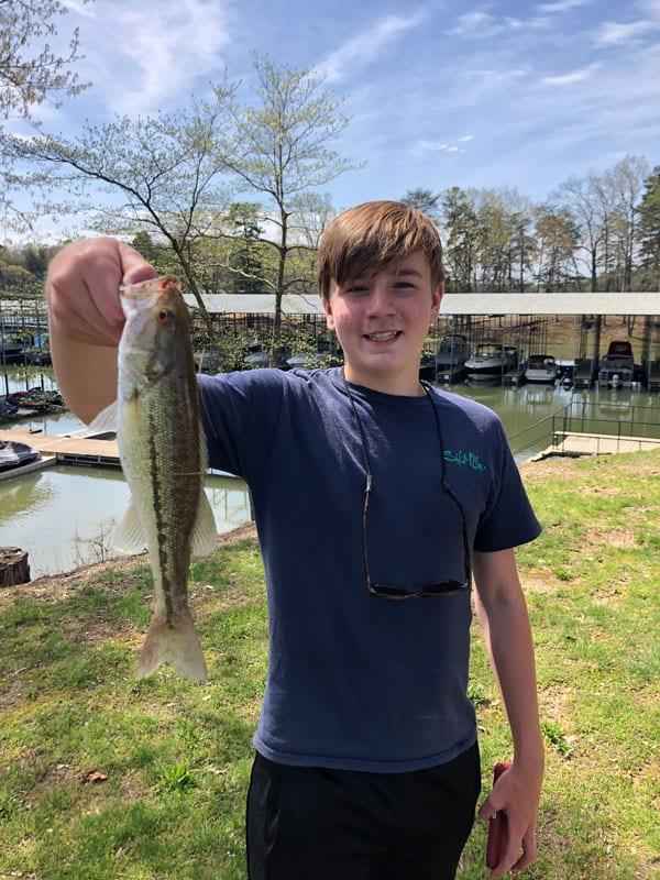 Teenage boy with fish