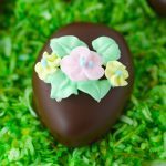 Chocolate covered peanut butter eggs with sugar flowers