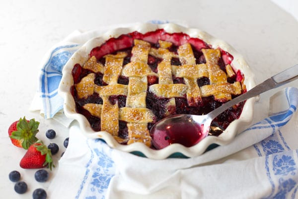 Baking Mixed berry cobbler with lattice crust