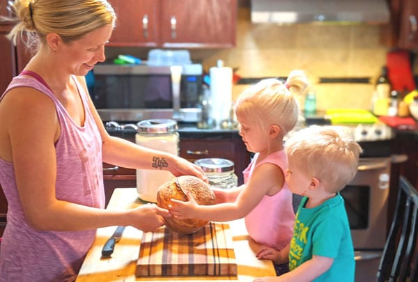 Heather baking sourdough bread with kids
