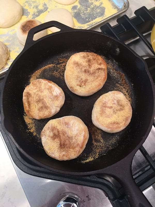 Frying Sourdough English Muffins in cast iron skillet
