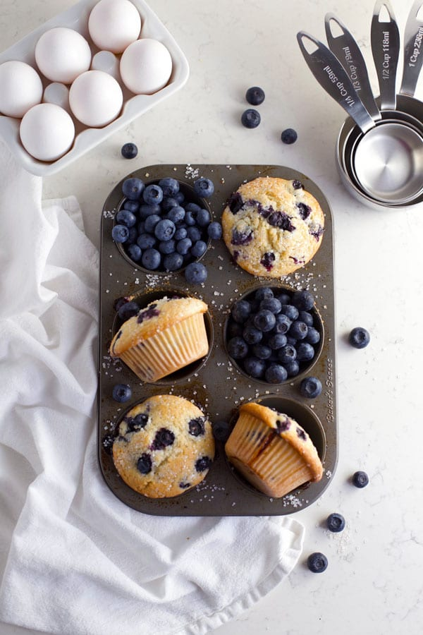 Sourdough lemon blueberry muffins in muffin pan