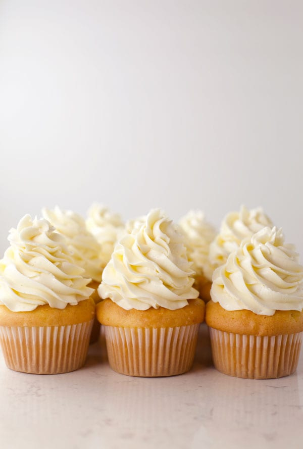 Swiss meringue buttercream cupcakes in a row