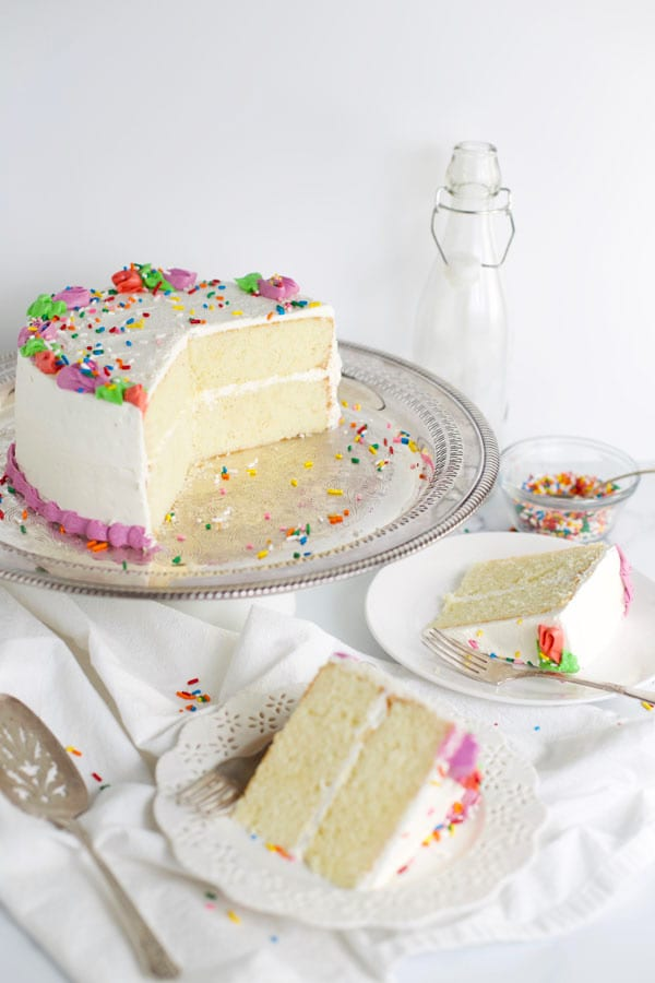 Slices of white cake on plates