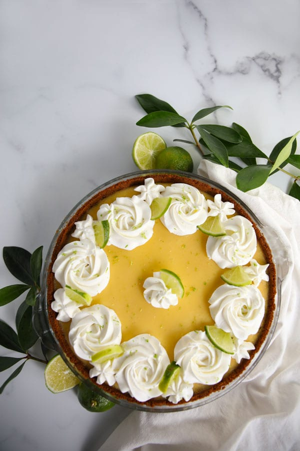 Flat lay shot of Classic Key Lime Pie with Whipped Cream