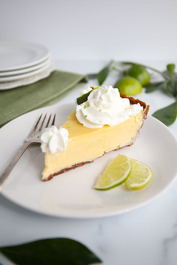 Slice of Classic Key Lime Pie with Whipped Cream
