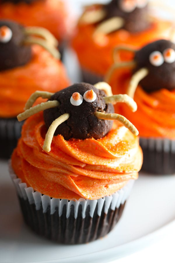 Cute halloween spider cupcakes are chocolate cupcakes with buttercream frosting and chocolate truffle spiders.