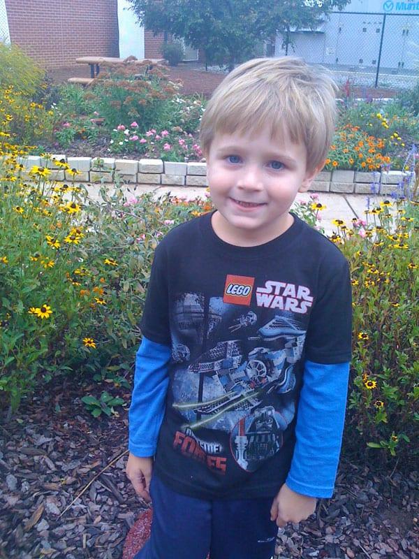 Little boy in a garden on his birthday