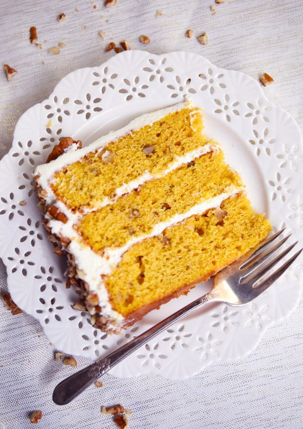Slice of cake pumpkin spice cake with cream cheese frosting