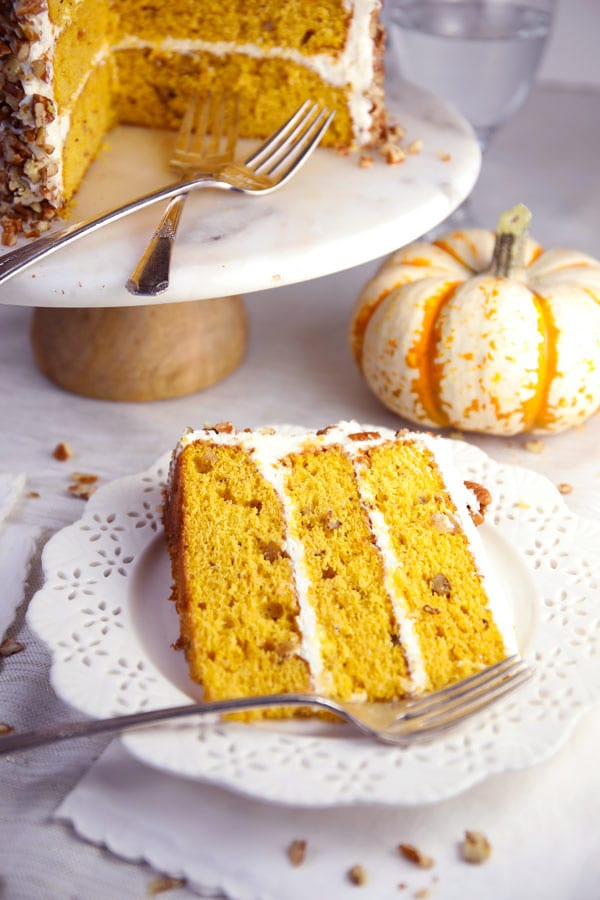 Pumpkin spice pecan layer cake with cream cheese frosting cake slice