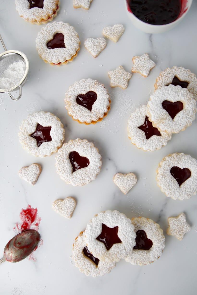 Gluten free raspberry jam filled almond linzer cookies star shaped