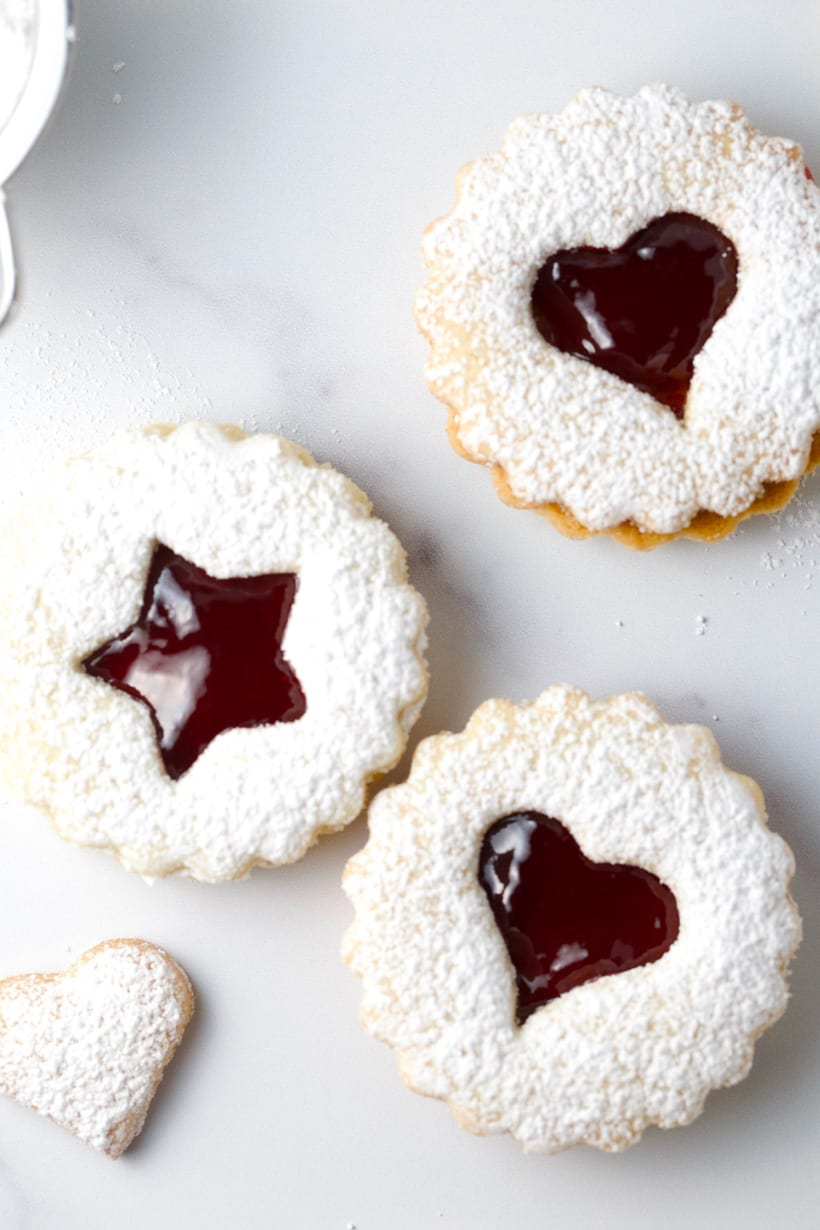 Raspberry jam filled almond linzer cookies gluten free holiday cookies