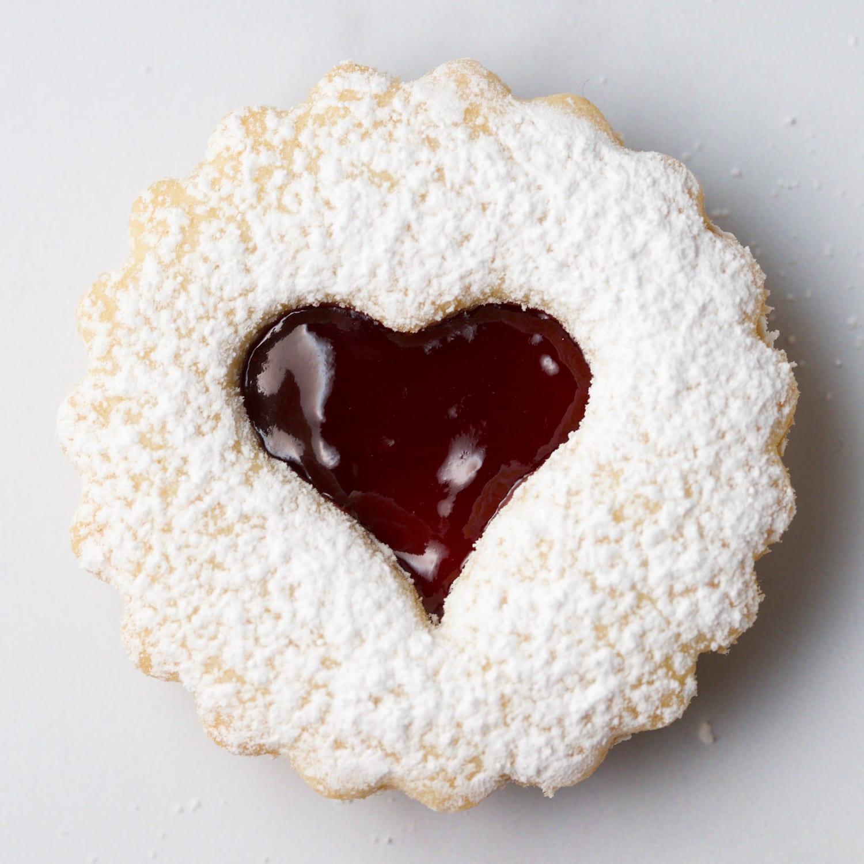 Raspberry jam filled buttery almond cookies gluten free linzer cookies