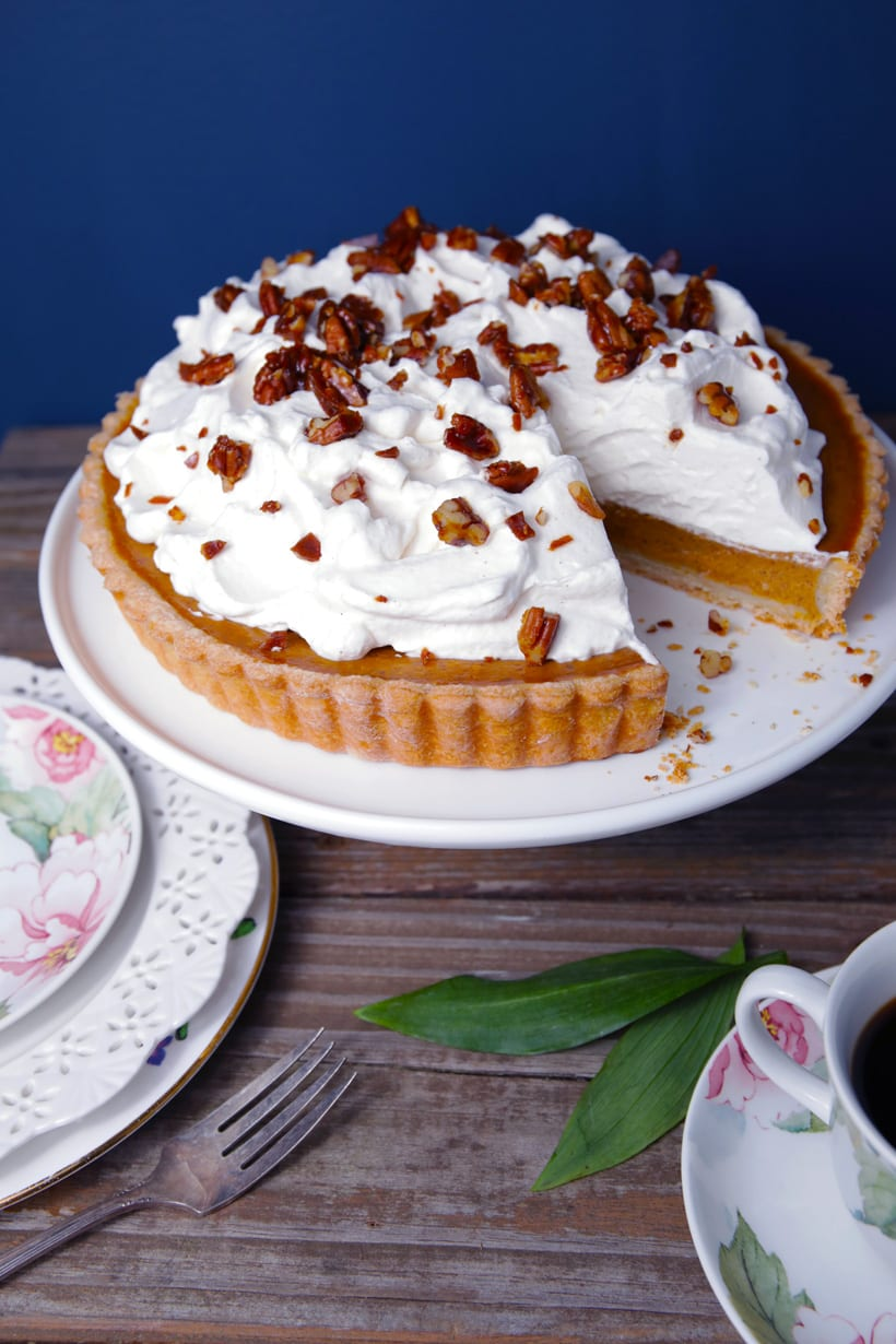 Turtle pumpkin pie with whipped cream and pecan toffee