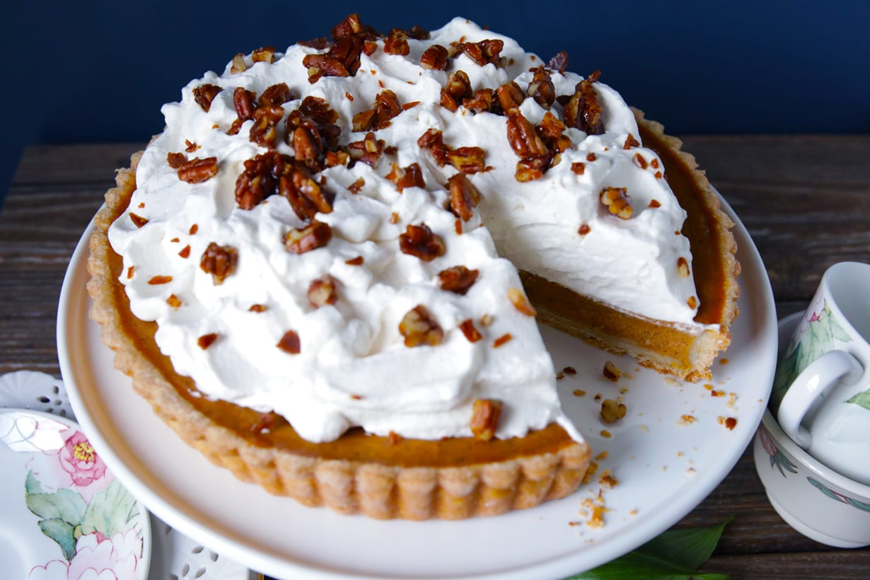 Turtle pumpkin tart with whipped cream and pecan toffee