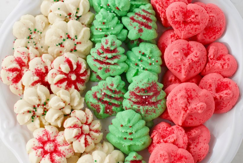 Classic Christmas Spritz cookies made with a cookie press
