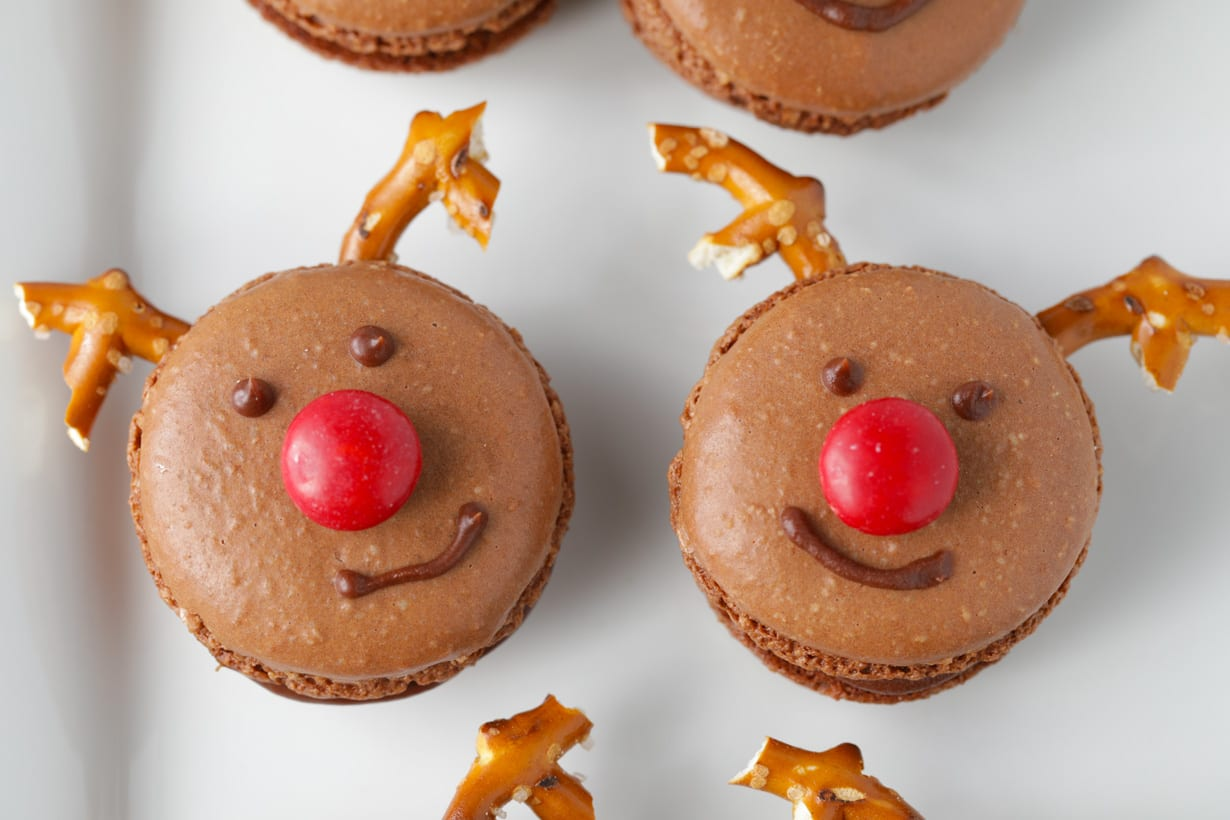 Homemade french macarons for christmas decorated like rudolph the red nosed reindeer