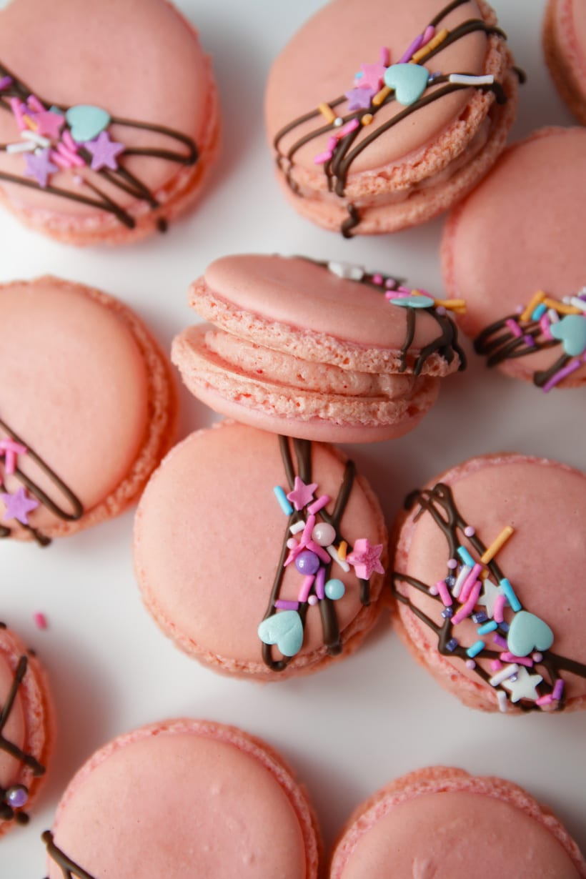 Pink macaron shells with strawberry buttercream filling
