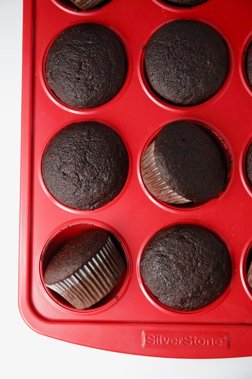 Homemade chocolate cupcakes in red muffin pan