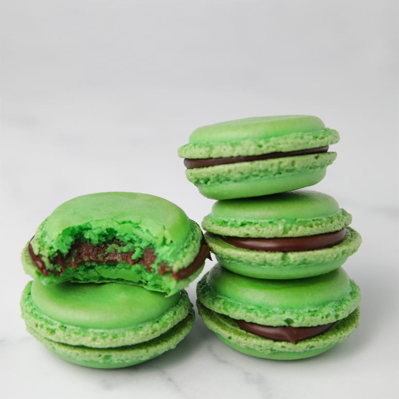 Stack of green macaron cookies with bite taken out