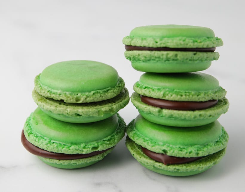 Stack of chocolate filled mint flavored macaron cookies