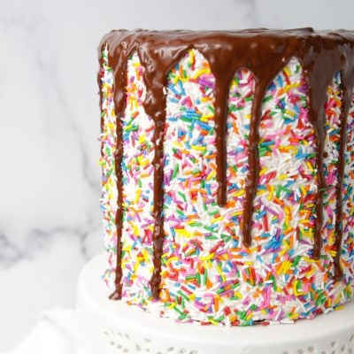Gluten free chocolate layer cake with buttercream, sprinkles and chocolate drip