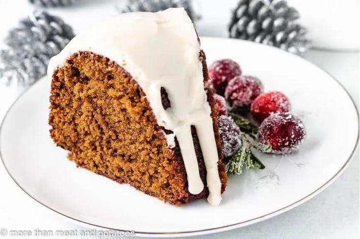 Gingerbread bundt cake sliced with vanilla glaze